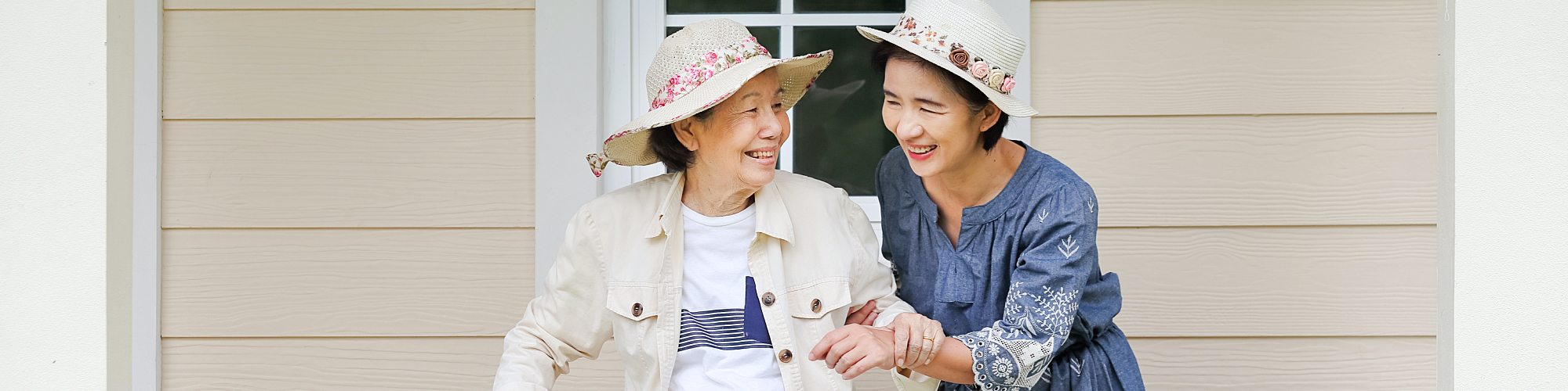 asian caregiver with asian elderly woman